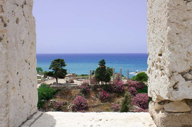 View over the ruins of Byblos from Crusader castle: temple amid oleanders.