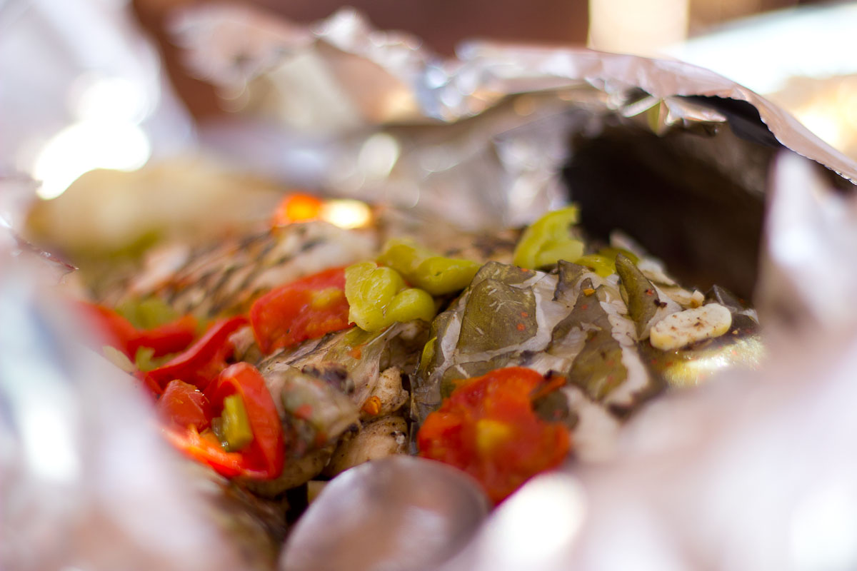 Bedouin fish cooked in foil with onions and peppers: this is a grouper.
