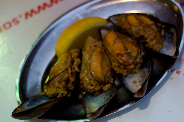 Stuffed mussels or midye dolma, served with lemon on a salver.