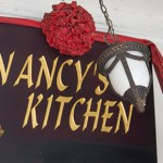 Sign for Nancy's Kitchen, the nyonya restaurant off Jonker Street, Malacca.