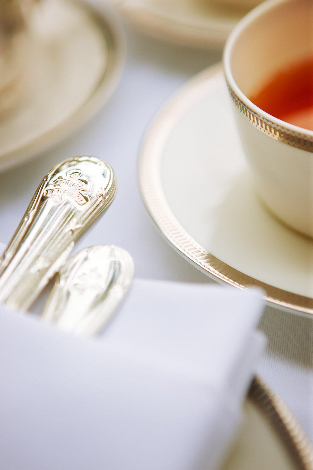Tea cup and silverware at Raffles high tea.